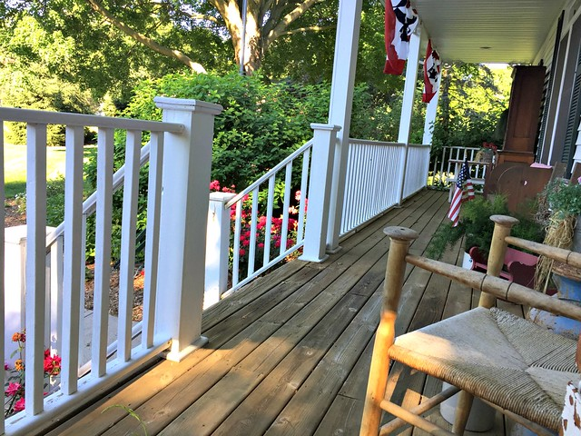 large front porch with American flags