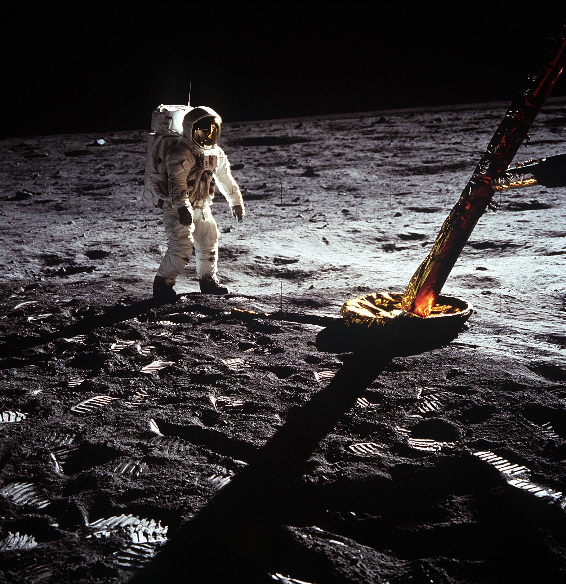 Astronaut Edwin Aldrin walks on lunar surface near leg of Lunar Module