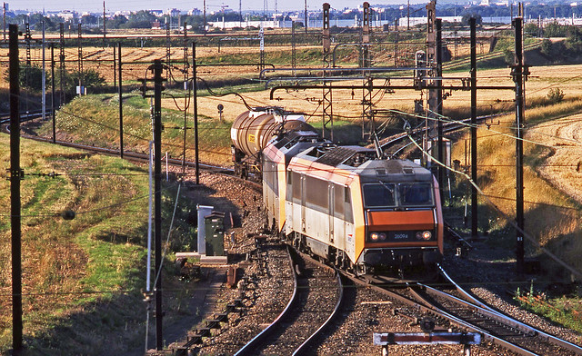 SNCF 'Sybics' 26094+26153 are super power for just two Simotra tanks and another vehicle seen arriving at Dijon Gevrey Chambertin Yard from an unknown origin. 19July2002