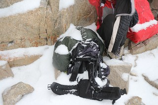 1701 My gear should still be dry under the piles of hailstones on my pack's rain cover - now to put it back   by _JFR_