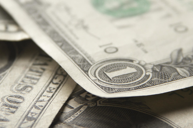Random pile of dollar bills