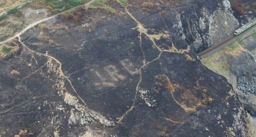 645x344-hidden-giant-wwii-warning-sign-uncovered-in-ireland-wildfire-1533635791103