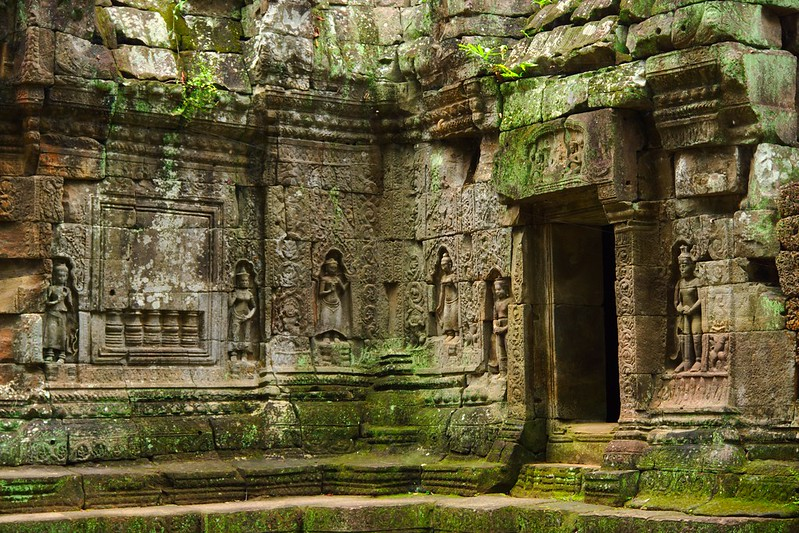 Stone carvings in the walls of Ta Som temple ruins in Angkor Archeological Park near Siem Reap, Cambodia