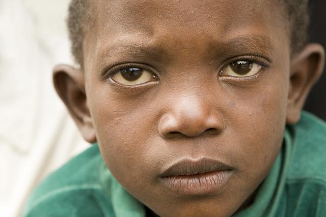 Boy Staring at School near Mount Meru