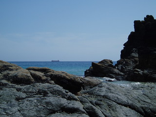 Rock simulacra with lone oil tanker on the horizon at Kynance Cove, The Lizard, Cornwall