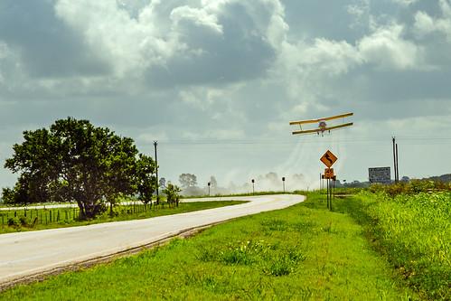 airplane biplane clouds cropduster plane sky brookshire texas unitedstates us