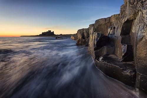 bamburgh bamburghcastle northumberland castle sunrise ocean waves water shortexposure canon5dmk3