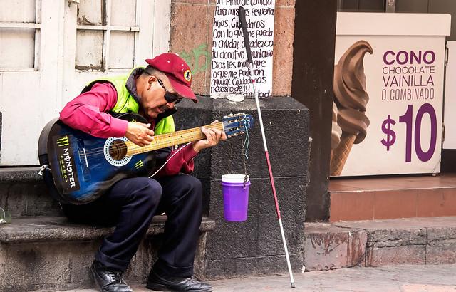 Blind Guitar Player
