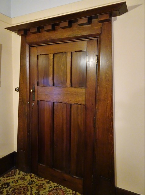 Grange. Adelaide. Beautiful wooden door with Aztec shape design in N'Kola Donga house. It was built in 1912 in American bungalow style.