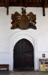 royal arms of Queen Anne and south doorway