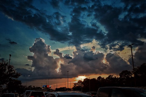 clouds skies thunderheads sunset dramaticskies iphonese snapseed stevefrenkel mariettaga cars trucks billboard trees parkinglotlights