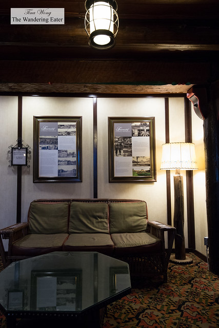 Second floor seating and historical photos of the hotel