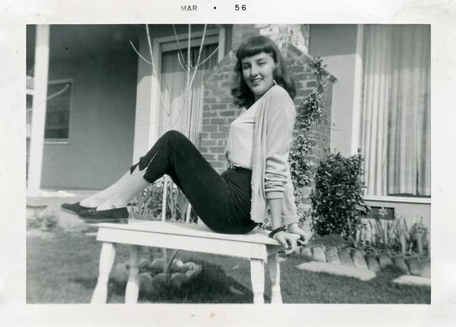 Teenage Girl Posing on Table Outside, 1956