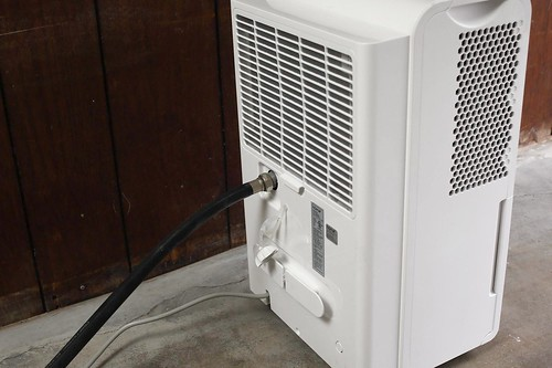 Dehumidifier with draining hose and ventilation grates | by yourbestdigs