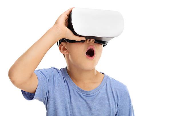 Amazed boy experiencing virtual reality - Credit to https://www.lyncconf.com/