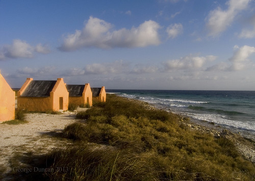 bonaire red slave huts caribbean seashore sunset