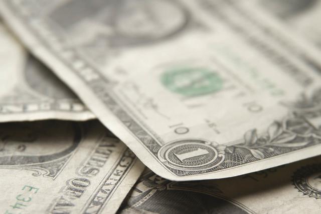 Scattered dollar bills short depth of field