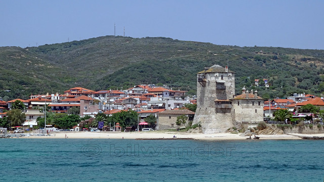 Greece, Macedonia, Aegean sea, Chalkidiki, Ouranoupolis tower view from a boat cruising around Mount Athos peninsula