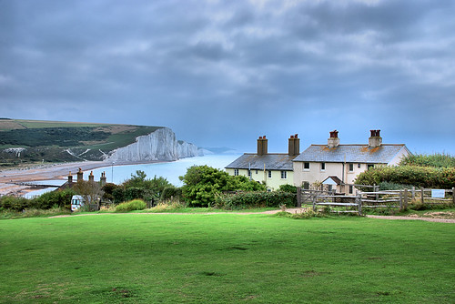 hdr cottages houses chimneys bushes sea ocean water cliffs grass landscape clouds scenic vista view sussex