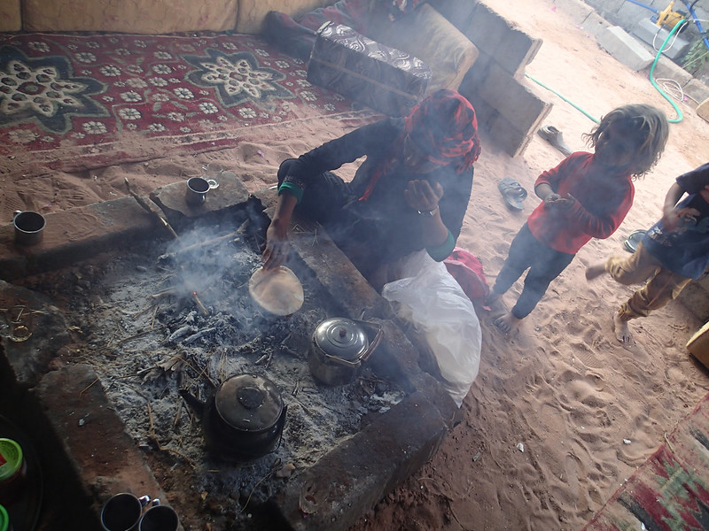 15 - Flat bread seems to be the staple food for Bedouins.  They are baked somewhere else, but are almost always reheated directly on firewood.