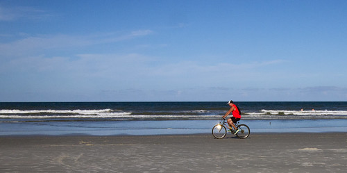 Red beach bicyclist
