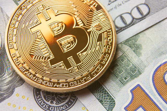 Gold Bitcoin on U.S. Currency