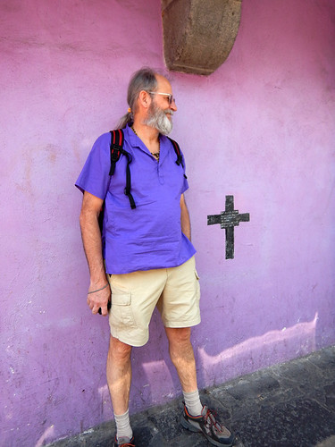 Al almost disappears against a purple wall in Puebla, a UNESCO Heritage site in Mexico