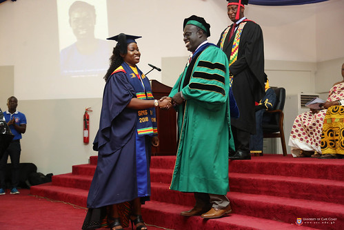 Overall best student, Ms. Lotachi Ugwunma Onyemenam, being congratulated by Prof. Eric Magnus Wilmot, Provost of the College of Education Studies, University of Cape Coast.