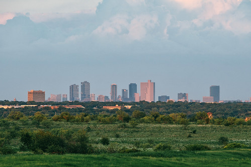 lenstagger fortworth fwtx cowtown tx texas fw downtown sunset buildings pasture green land urbanarea telephoto longlens canonfd canonfd300mmf4l 300mm sonymirrorless sony a7riii