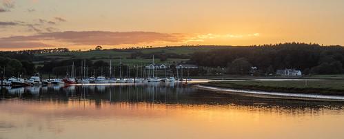 sunset marina boats water river
