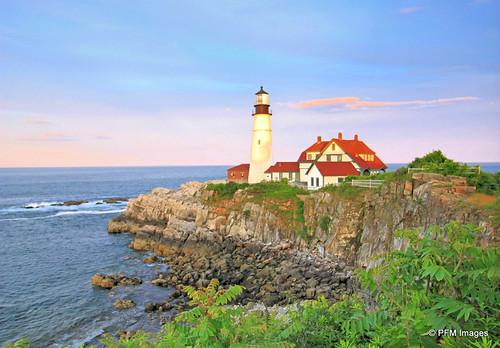 sunset portland headlight light lighthouse ocean coast coastal maine newengland sea rocks rocky shore