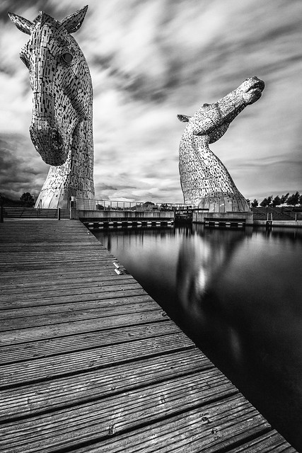 fine art black & white long exposure, ND filter, of The majestic Kelpies towering over the Forth & Clyde Canal, Falkirk, Scotland, UK