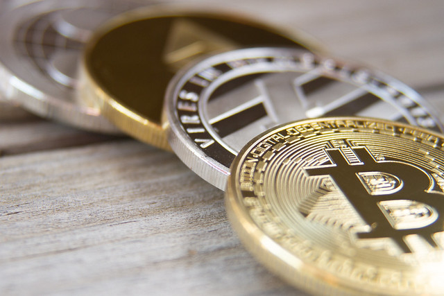 Curved row of crypto coins