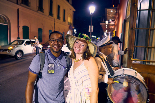 Red Bull photographer and Melanie Merz with Treme Brass Band in the background at the WWOZ Groove Gala on Sep. 6, 2018. Photo by Eli Mergel.