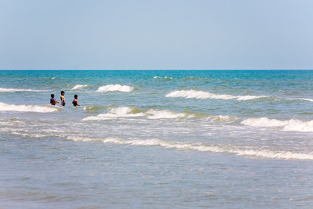 Children playing in surf at Mustang Beach in Port Aransas Texas