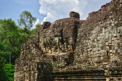 Reclining Buddha image at the west side of the Baphuon temple ruins in Angkor Thom in Angkor Archeological Park near Siem Reap, Cambodia