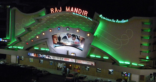 Raj Mandar cinema at night lit-up with green neon in Jaipur, India
