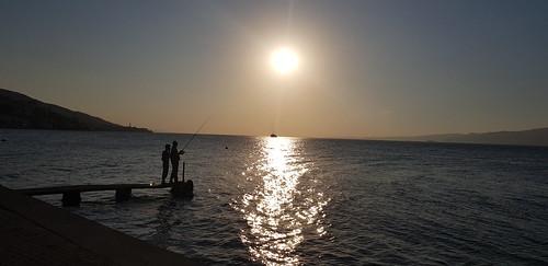 sunset sun sea fishing people