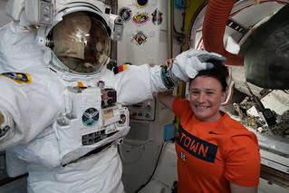 NASA astronaut Serena Auñón-Chancellor poses with a U.S. spacesuit | by NASA Johnson