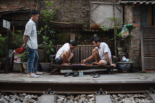Playing board games in Hanoi's Train Track Street