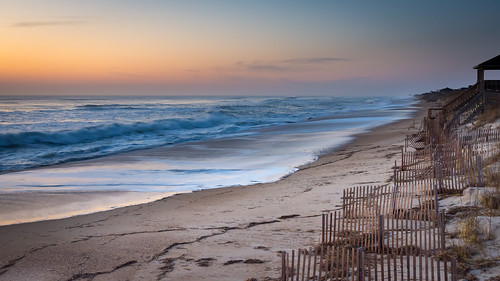 nagshead northcarolina unitedstates us obx outerbanks ocean waves sunrise water sand beach fence sky sea