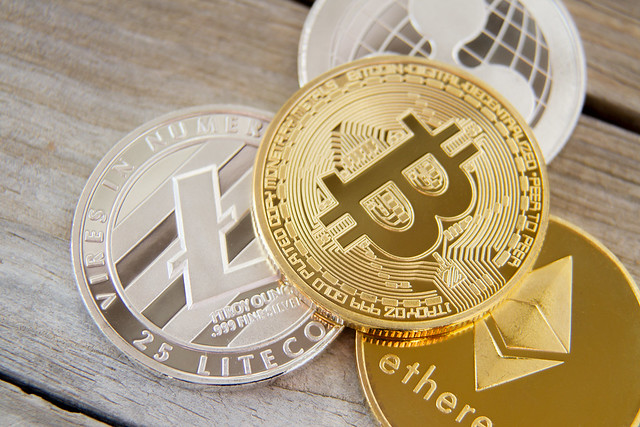 Crypto coins on wood planks