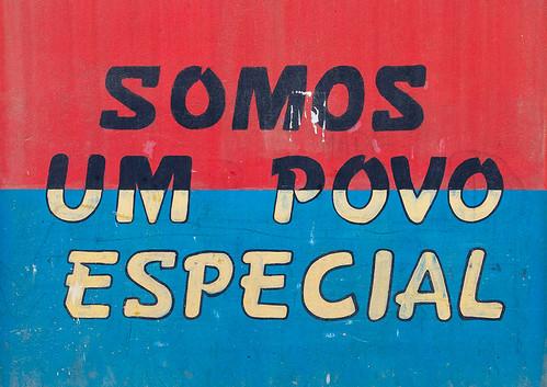 Patriotic slogan on a wall, Benguela Province, Catumbela, Angola   by Eric Lafforgue