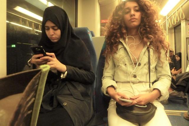 Two girls in public transport