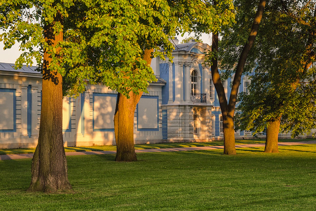 The walls of Smolny cathedral under sunset light.