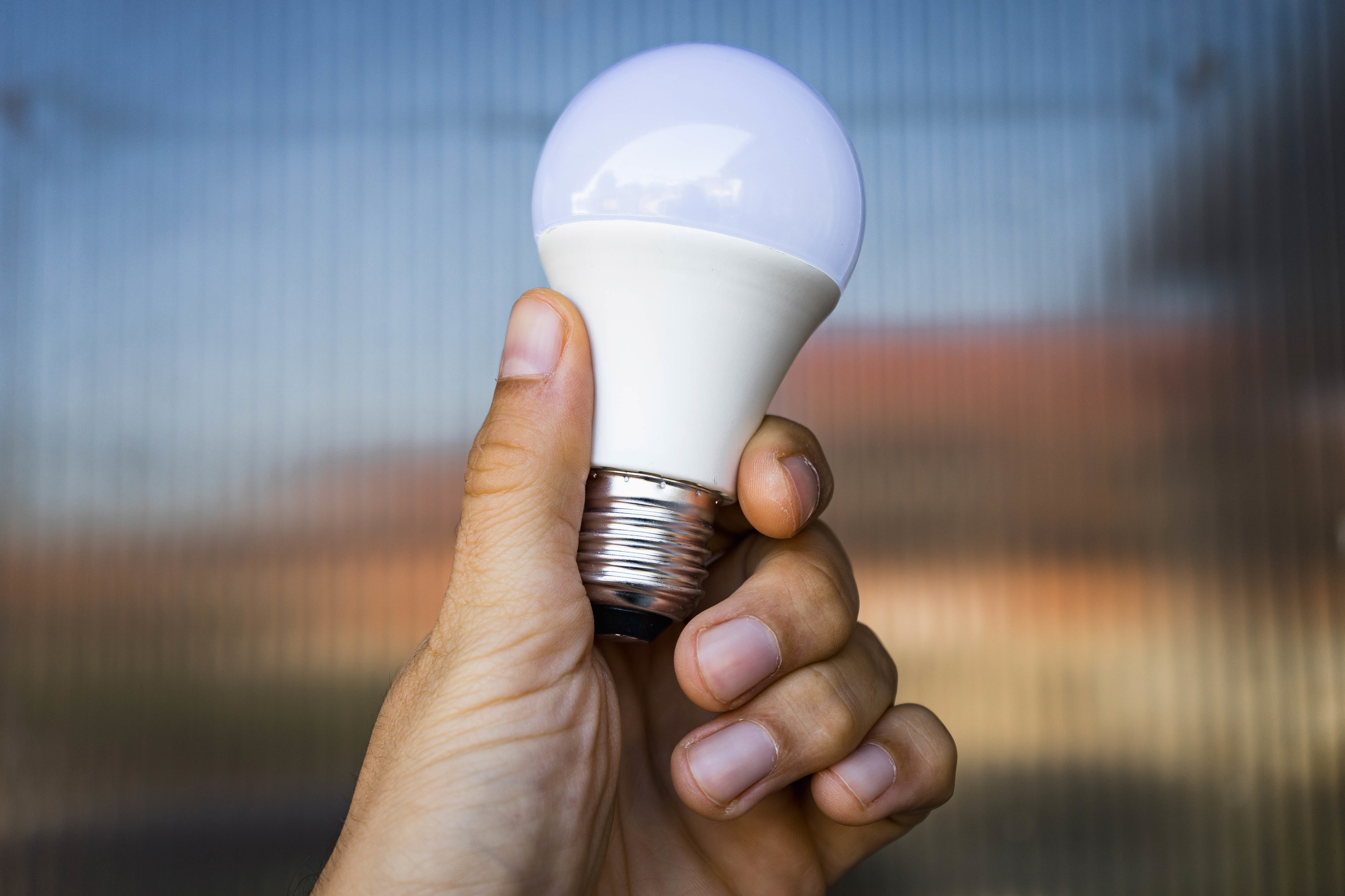 Close Up on a LED Light Bulb in the Hand