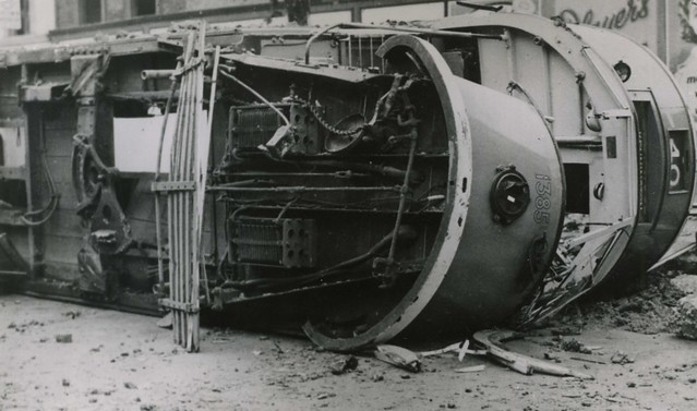 10 Sep 1940 – London Tram 1385 on it's side separated from is trucks. Bomb damage.