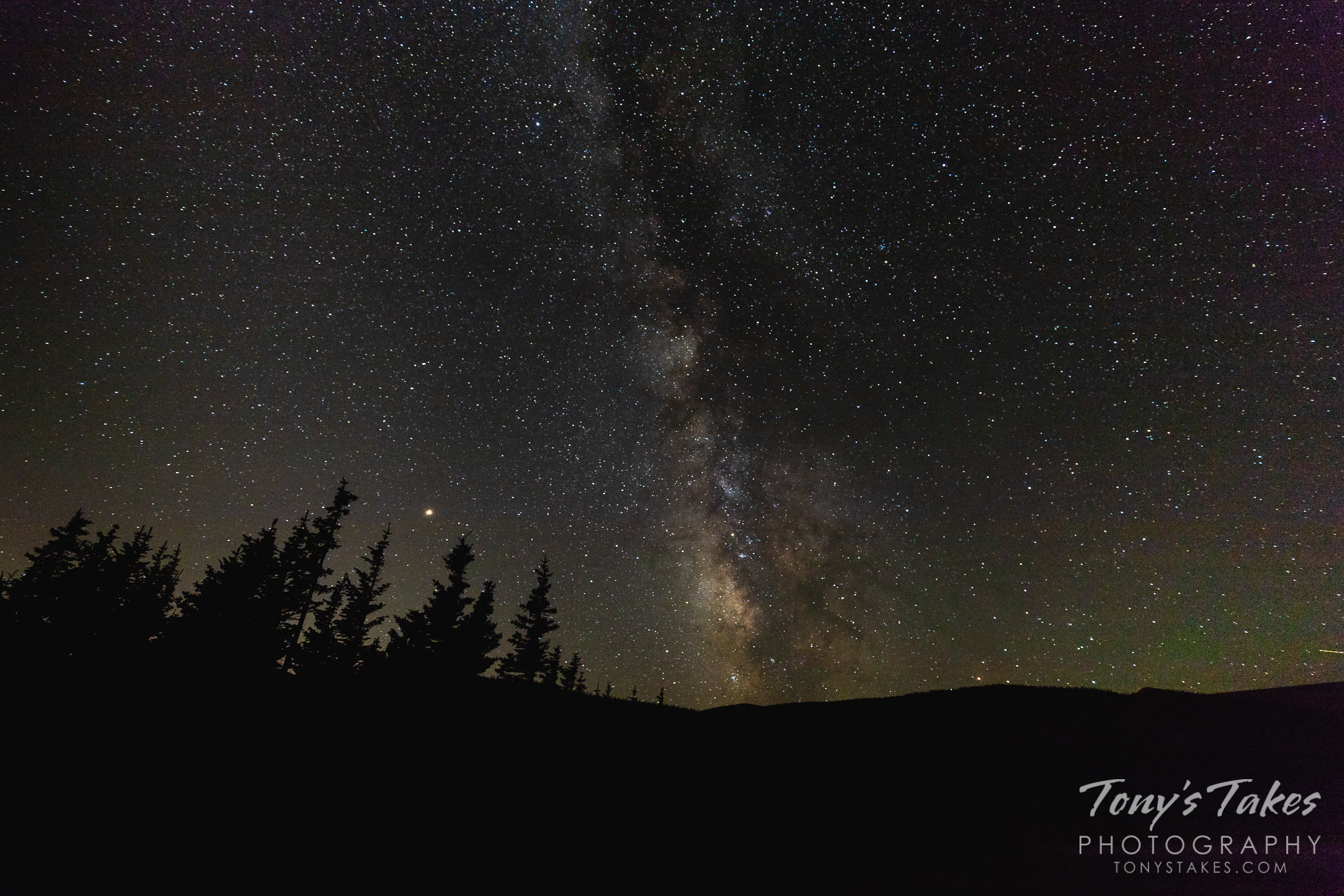 The Milky Way and the planet Mars are seen during the summer in Colorado's high country. (© Tony's Takes)