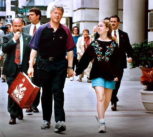Bill Clinton walks with his daughter Chelsea from the B. Dalton bookstore