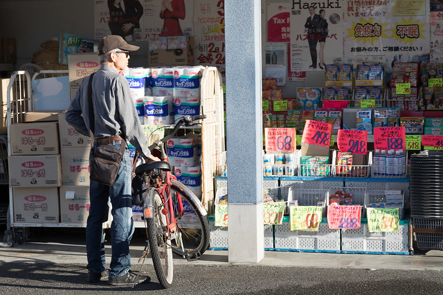Man on bike by discount store, Nara, Japan EXPLORED